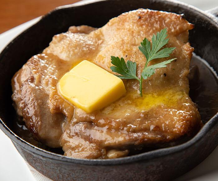 大山鶏の日本酒仕立て・焦がしバターソース